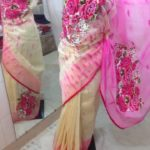 Cream color body & Pink color Acho with pink color work. A broad shade on Paar. Applique Work on Jamdani Shari